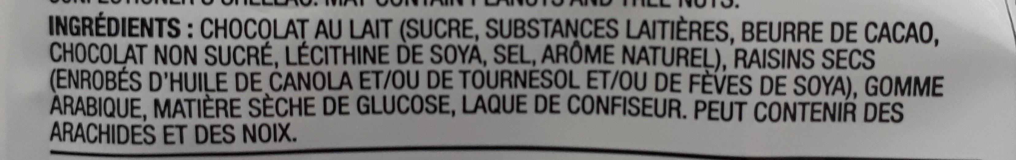 Milk chocolate covered raisins - Ingredients - fr