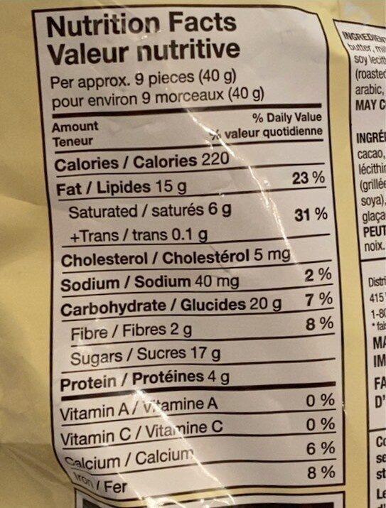 Amandes enrobées de chocolat au lait - Nutrition facts - en