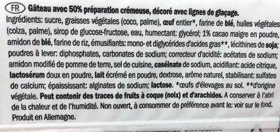 Gâteau avec 50% préparation crémeuse, décoré avec lignes de glaçage - Ingrédients - fr