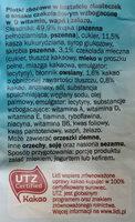 Płatki zbożowe w kształcie ciasteczek o smaku czekoladowym wzbogacone w 9 witamin, wapń i żelazo. - Ingredients