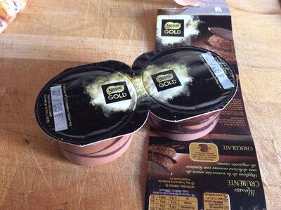Mousse de chocolate con finas y crujientes láminas de cacao - Producte