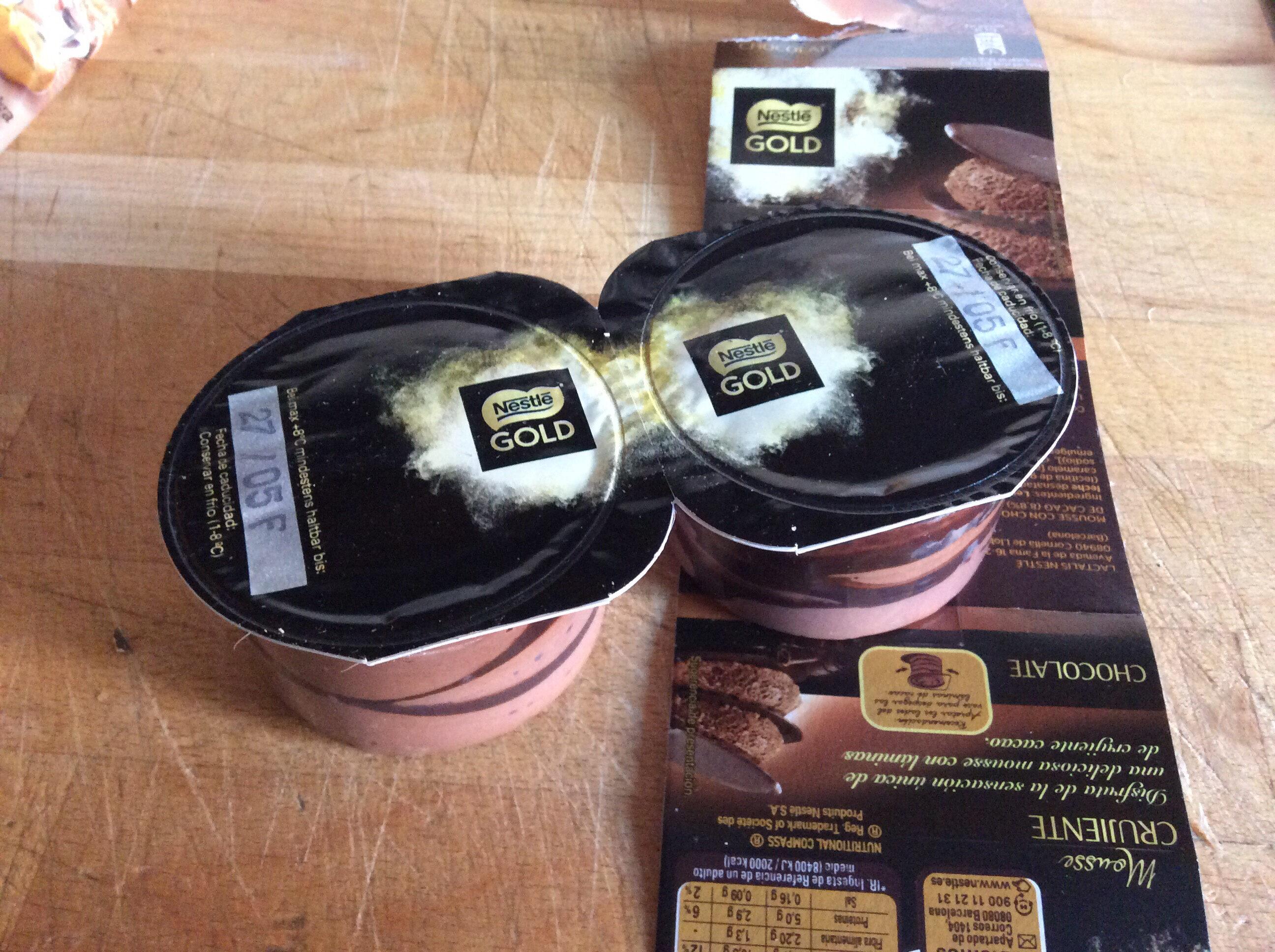 Mousse de chocolate con finas y crujientes láminas de cacao - Producte - es