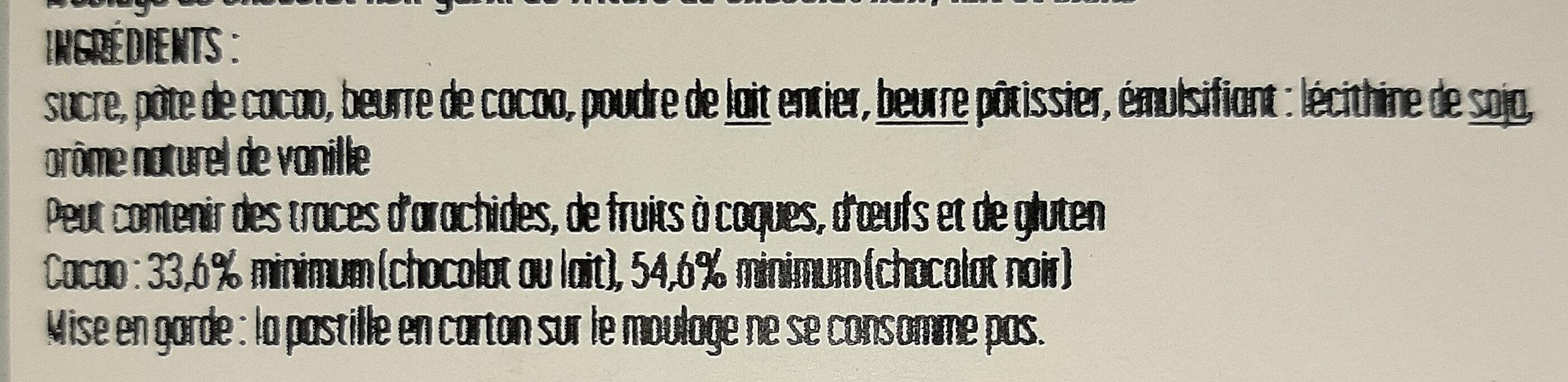 Oeuf ligne garni de fritures assortie. Chocolat noir - Ingredienti - fr