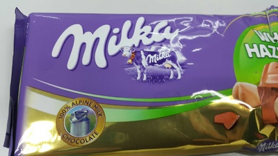 Milka chocolate tablet milk with whole nuts - Produit