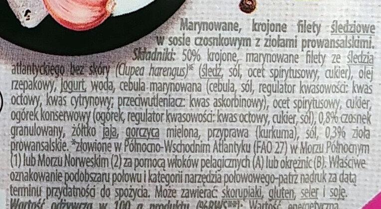 Marynowane, krojone filety śledziowe w sosie czosnkowym z ziołami prowansalskimi. - Składniki - pl