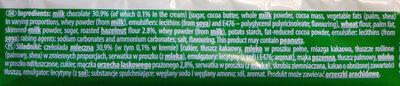Wafel przekładany kremem orzechowym w czekoladzie mlecznej. - Składniki