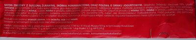 Baton zbożowy z suszoną żurawiną, skórką pomarańczową oraz polewą o smaku jogurtowym. - Składniki