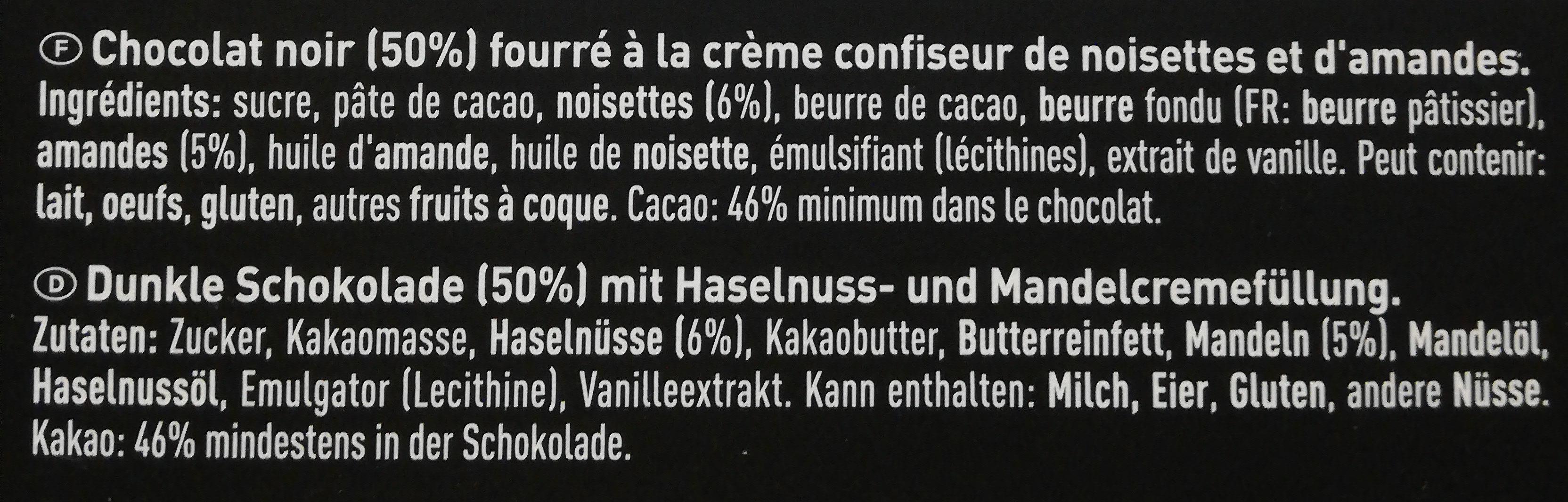 Of Switzerland FRIGOR NOIR CHOCOLAT NOIR FIN FOURRÉ À LA CRÈME DE NOISETTES ET D'AMANDES - Ingredienti - fr