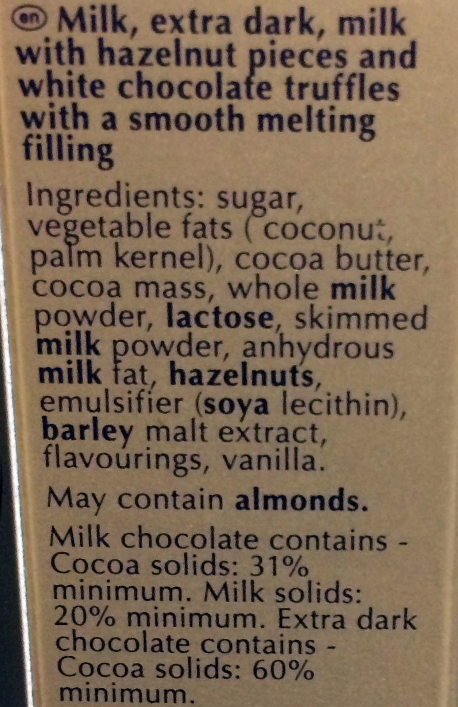 Milk, extra dark,mailk with hazelnuts pieces and white choclate truffles with a smooth melting filling - Ingredients