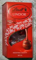 Pralinki z czekolady mlecznej z delikatnie rozpływającym się nadzieniem (44%). - Produkt - de