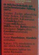 Pralinki z czekolady mlecznej z delikatnie rozpływającym się nadzieniem (44%). - Zutaten - de