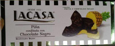 Piña confitada con chocolate negro