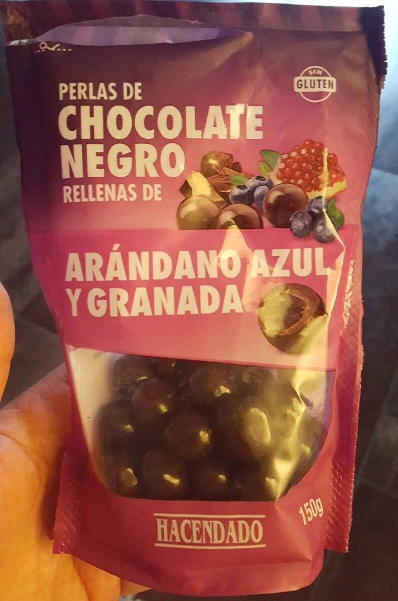 Perlas de chocolate negro rellenas de arándano azul y granada - Producte - es