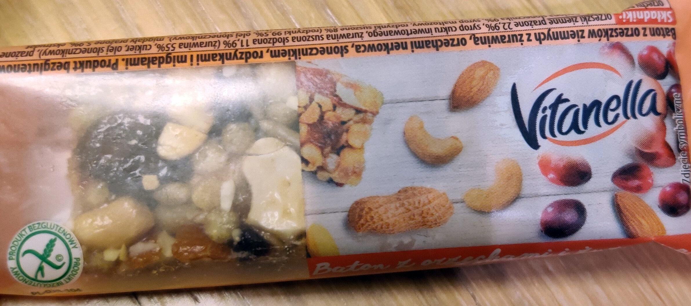 Baton z orzeszków ziemnych z  żurawiną, orzechami nerkowca, słonecznikiem, rodzynkami i migdałami. - Produkt