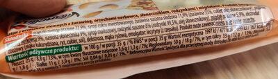 Baton z orzeszków ziemnych z  żurawiną, orzechami nerkowca, słonecznikiem, rodzynkami i migdałami. - Składniki - pl